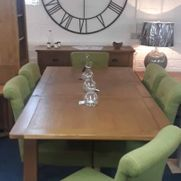 Tuscany oak dining set. Shop floor clearance, extending oak table + 4 olive fabric low back chairs. Was £1215 now £975