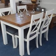 extending painted table set with 4 grey fabric seat chairs