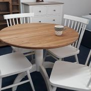 Painted bistro set. Finished in old white with solid oak top. Round pedestal table and 4 stick back chairs £595