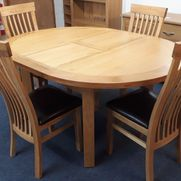 Oak round extending table + 4 chairs was £1175 now £929